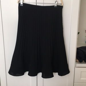 Fancy pleated black skirt.